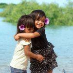 Photoshoot for BRAMS little girls hugging